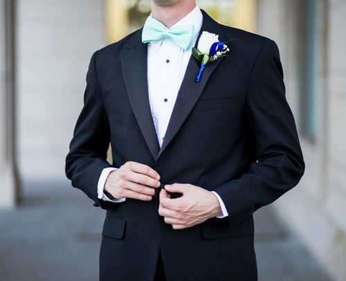 groom wedding planning man wearing black and teal tuxedo