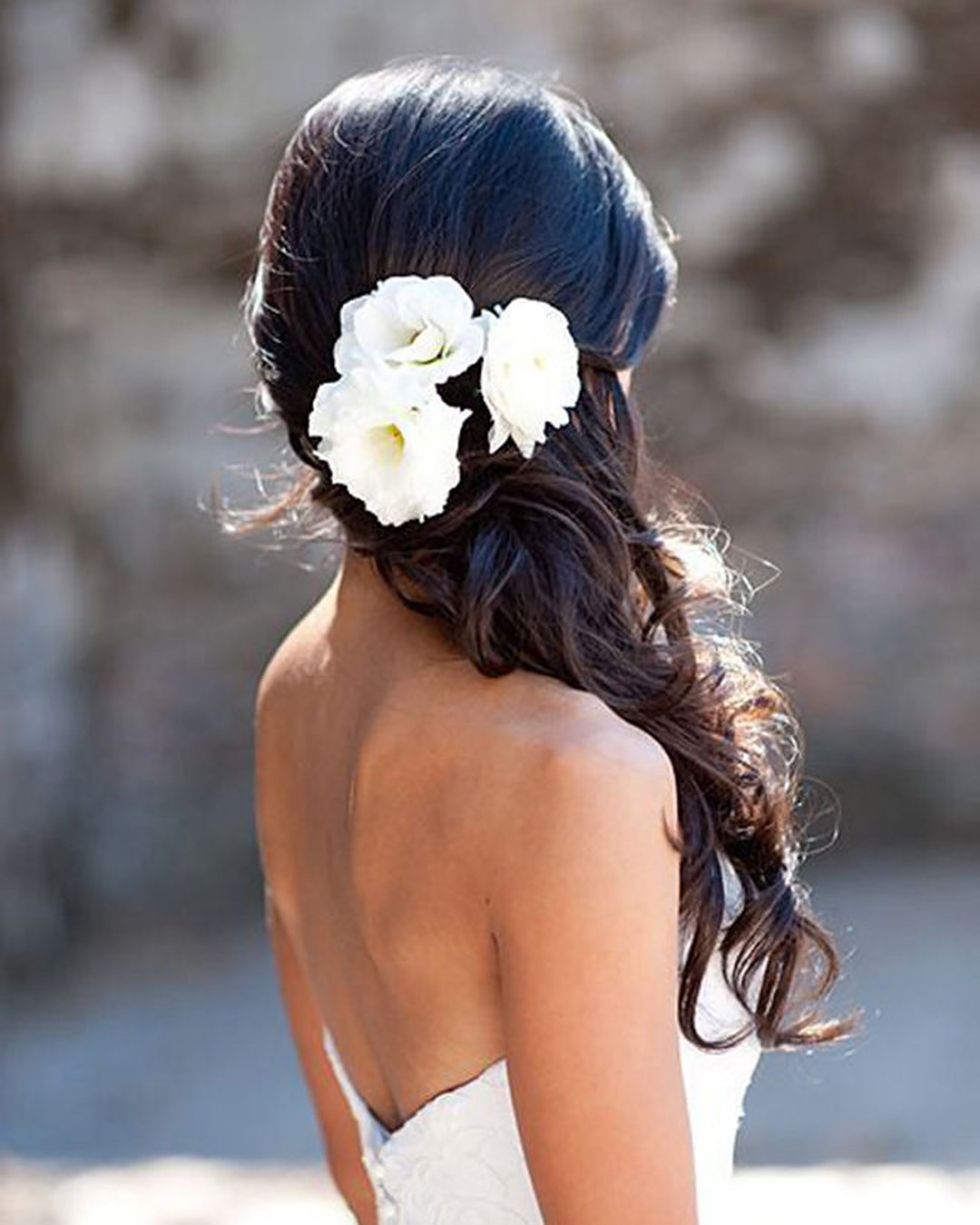 half up half down wedding hairstyles one side swept with white flowers elstile