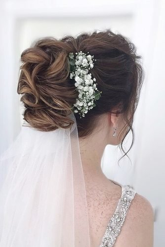 wedding hairstyles for curly hair classy updo bun with veil and flowers julia_alesionok