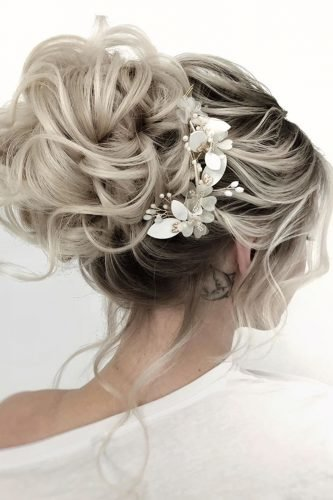 wedding hairstyles for medium hair high bun with loose curls and white flower pins juliafratichelli.bridalstylist