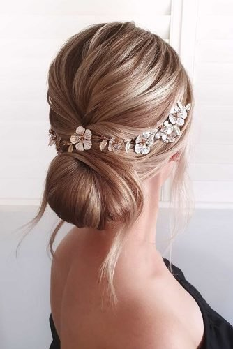 wedding hairstyles for medium hair low chignon with gold flower halo cathughesxo