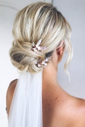 wedding hairstyles with veil elegant low bun with pins polishedstylejustine