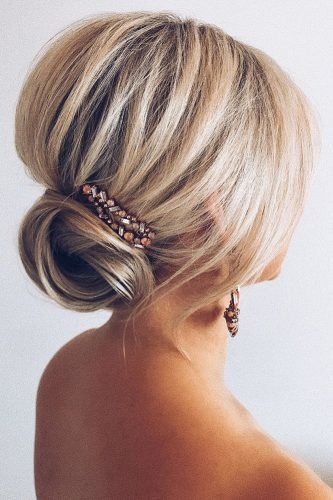 wedding updos for medium hair volume updo with bun with accessorie polishedstylejustine