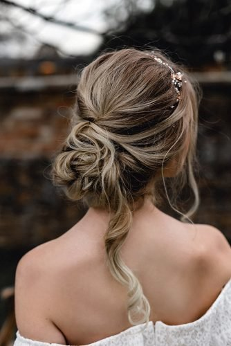 boho wedding hairstyles messy low chignon bun with loose curl masha.unwerth