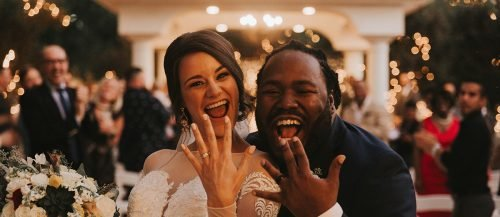 funny wedding songs newlyweds showing off rings featured