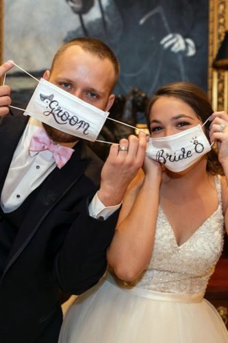 bridal survival guide groom and bride in surgical face mask with signs koontzphotography