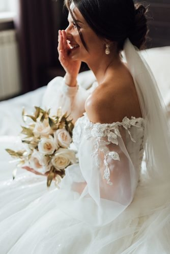 bridal survival guide wedding dress on bride with white bouquet wona nyc