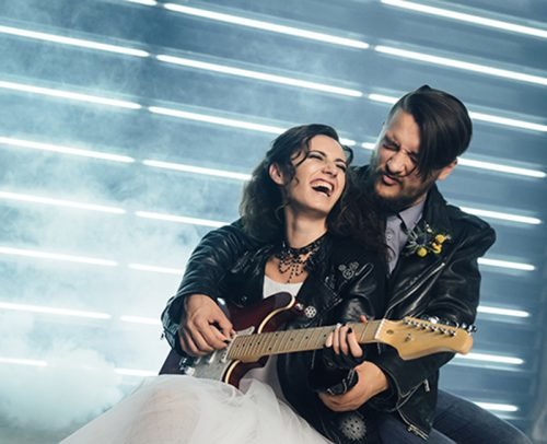 modern rock wedding songs bride and groom with guitar