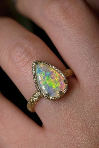 opal engagement rings modern yellow gold pear cut