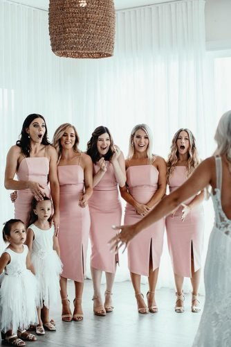 wedding photography trends with bridesmaids in pink dresses first look ivyroadphotography