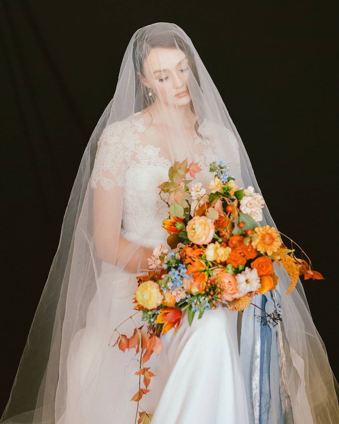 wedding colors yellow orange bride bouquet