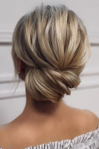 bridesmaid hairstyles side swept textured chignon tonyastylist