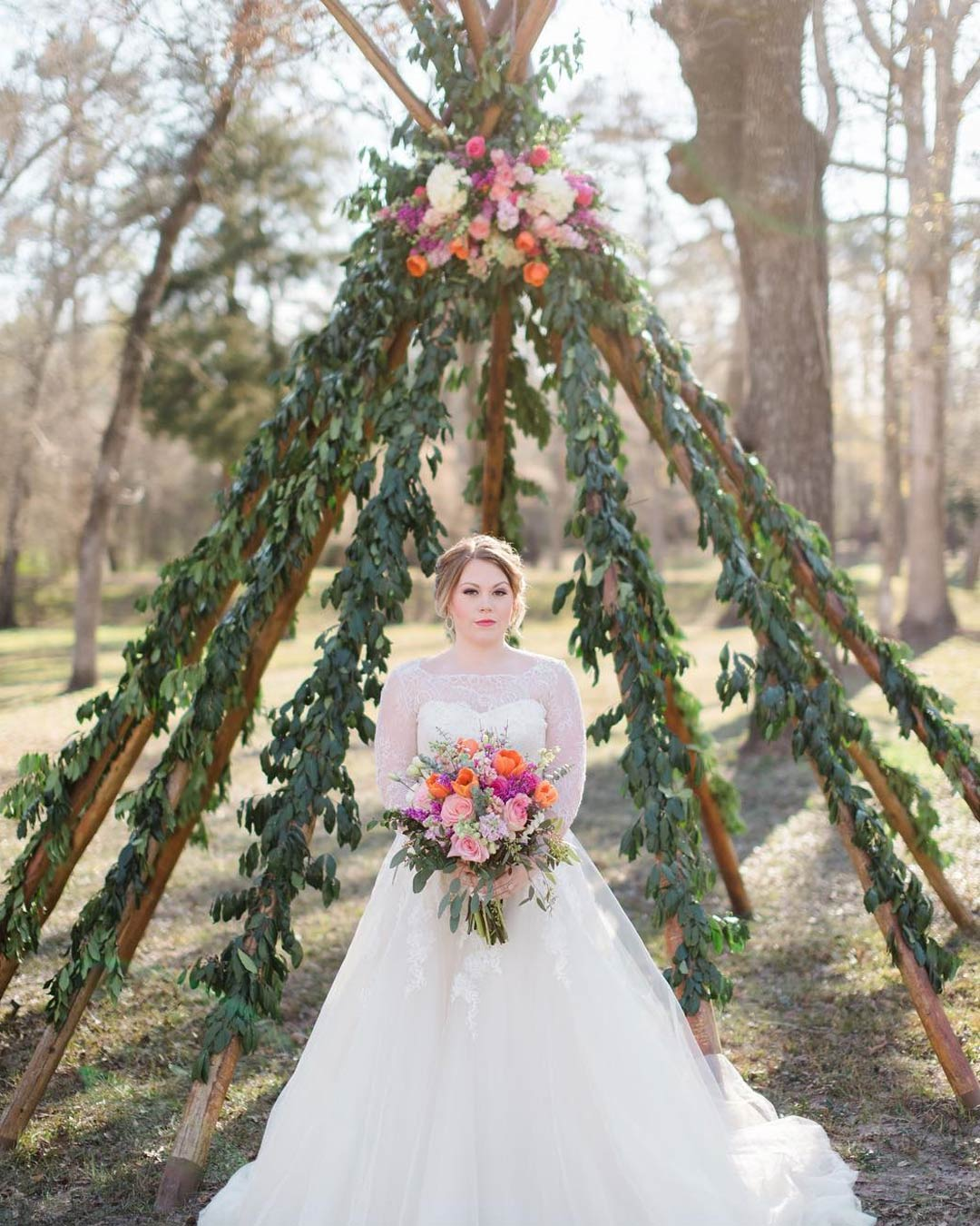 rustic wedding ideas bride dress flowers bouquet wooden arch greenery backdrop