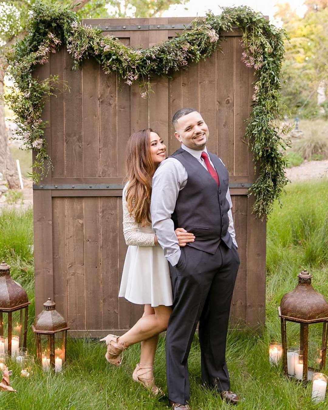 rustic-wedding ideas guests attire backdrop greenery candles