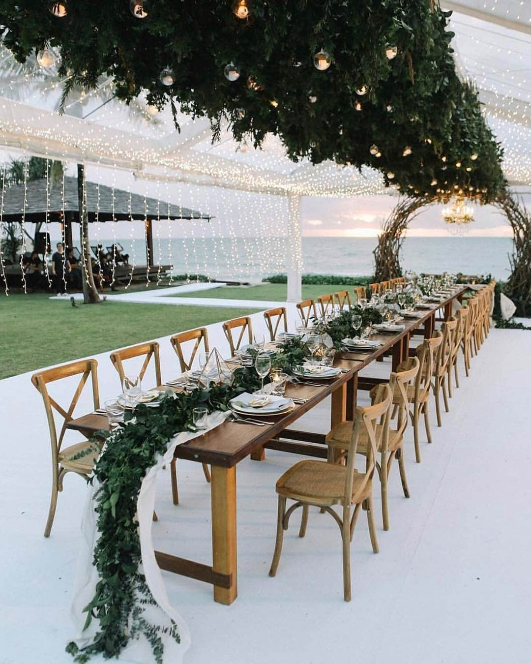 rustic wedding ideas lights seating table greenery