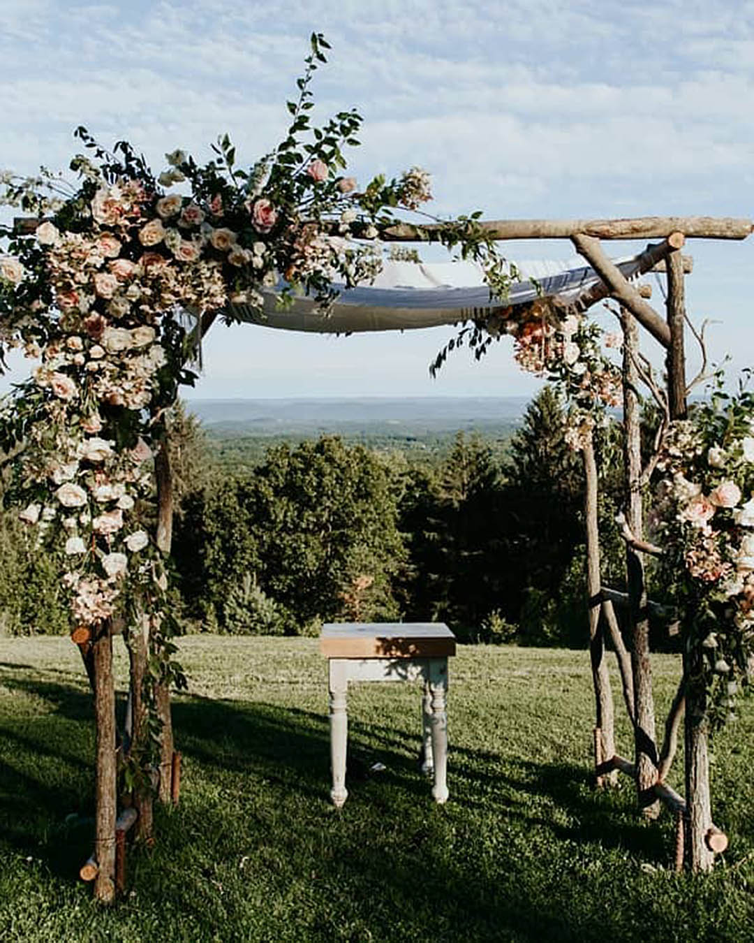 wedding trends birch arch with flowers
