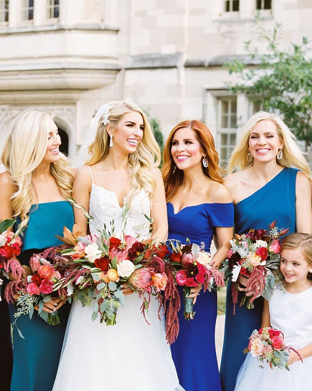 wedding trends bride with bridesmaids in blue dresses