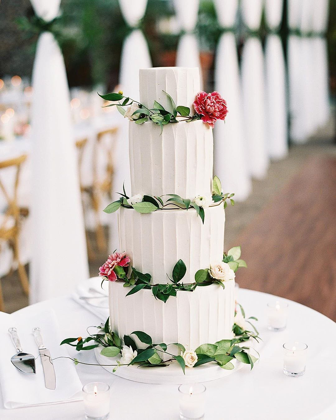 wedding trends white wedding cake with greenery