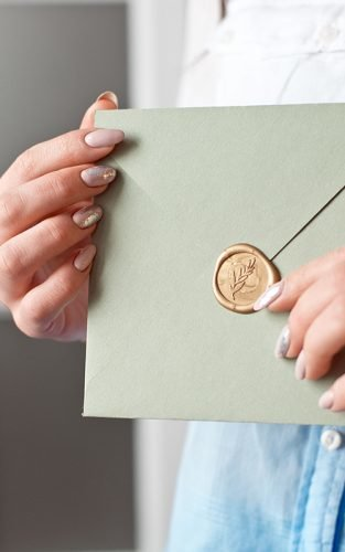 wedding wishes woman holding envelope wish