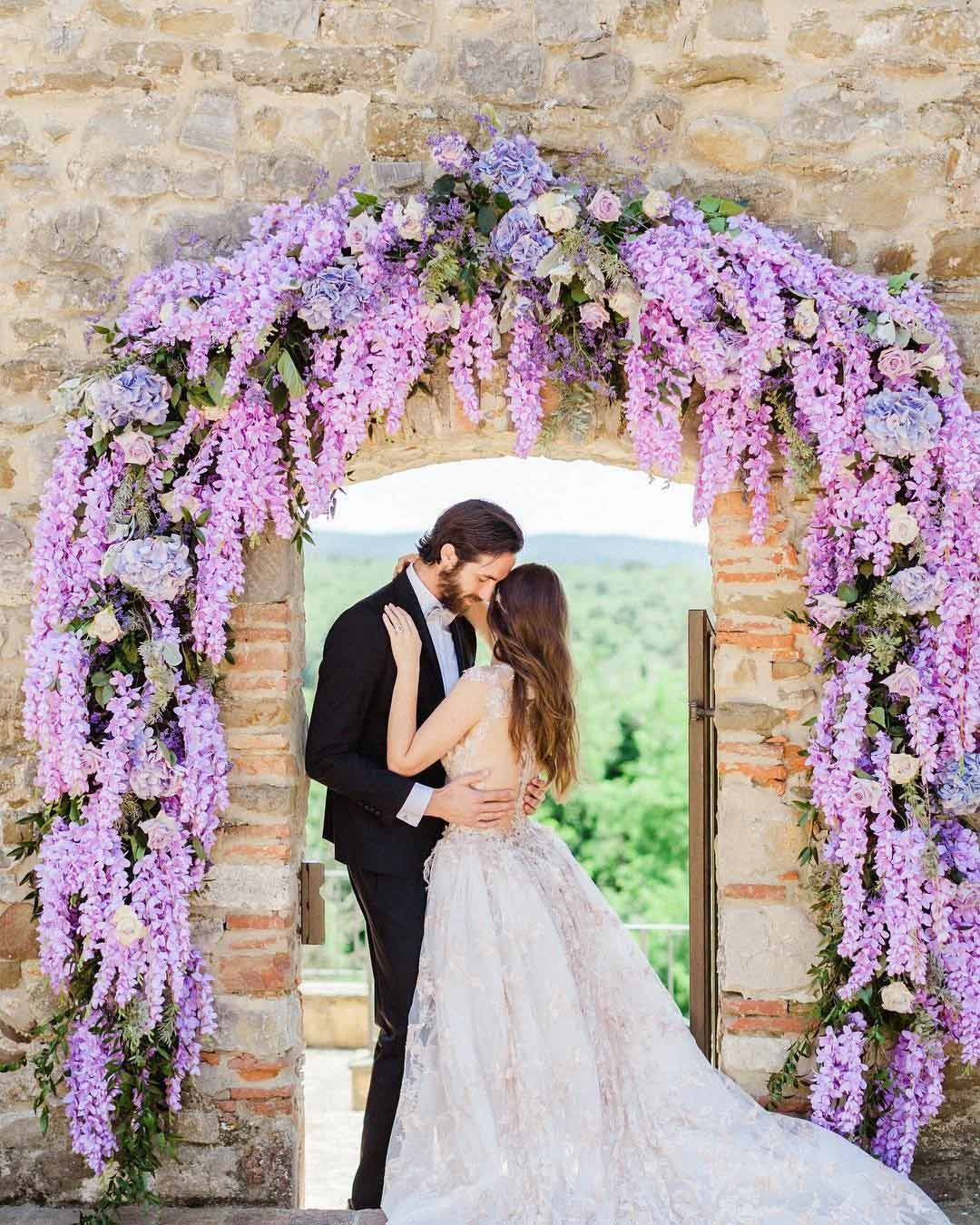 lilac wedding colors flower arch bride groom-
