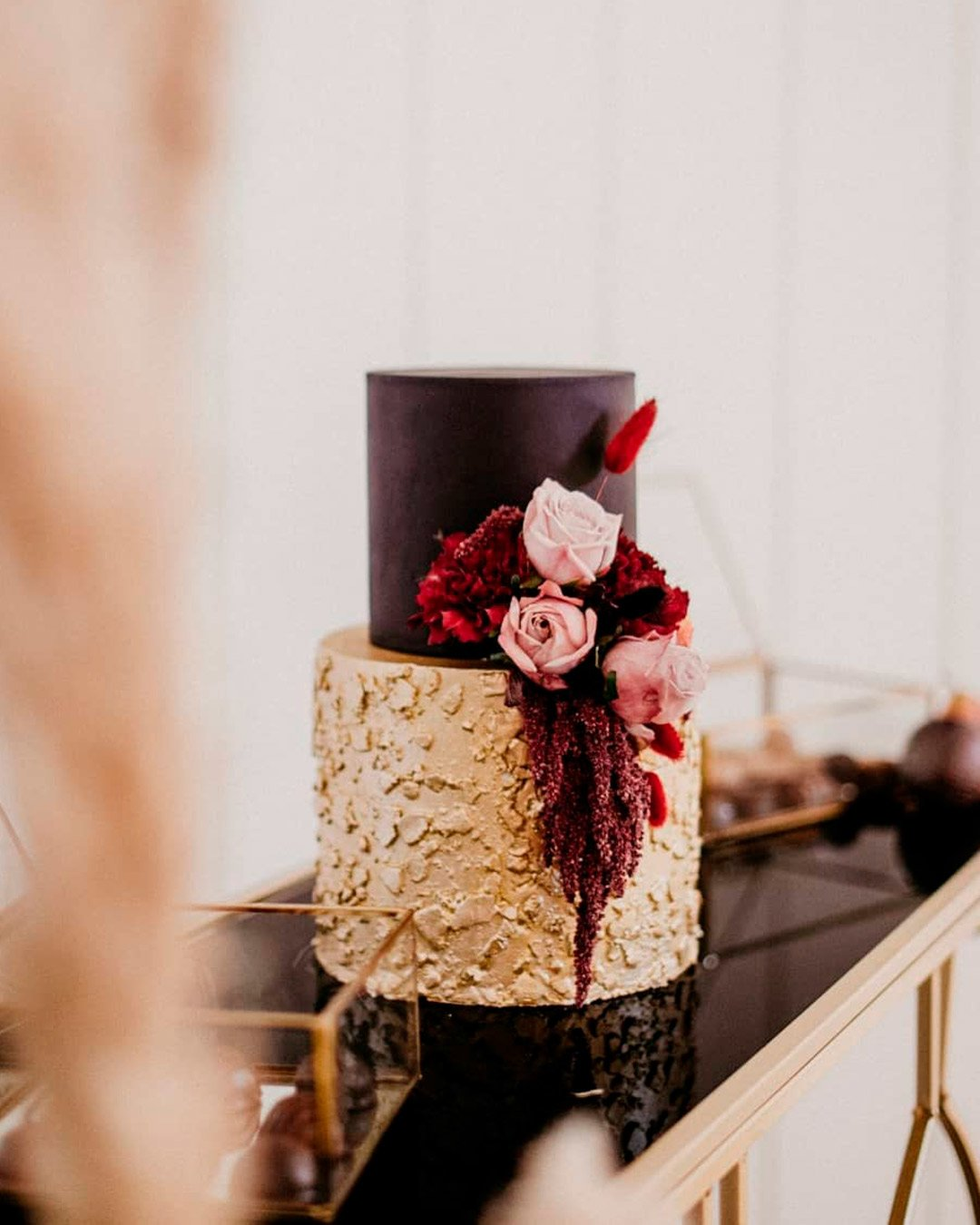 wedding trends gold burgundy flowers cake