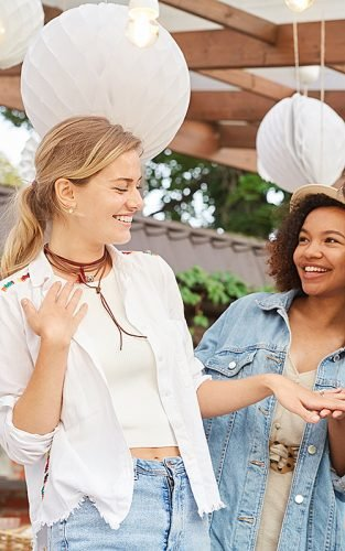 how to plan a bachelorette party friends looking at engagement ring featured