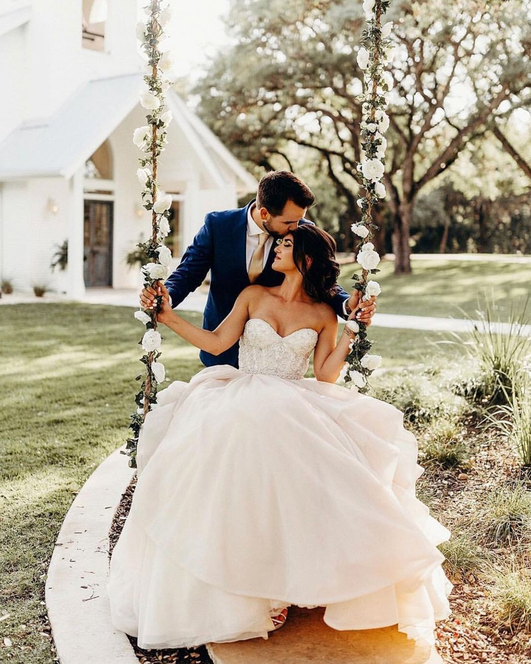 cute wedding photos couple on swing under tree rachelantigua