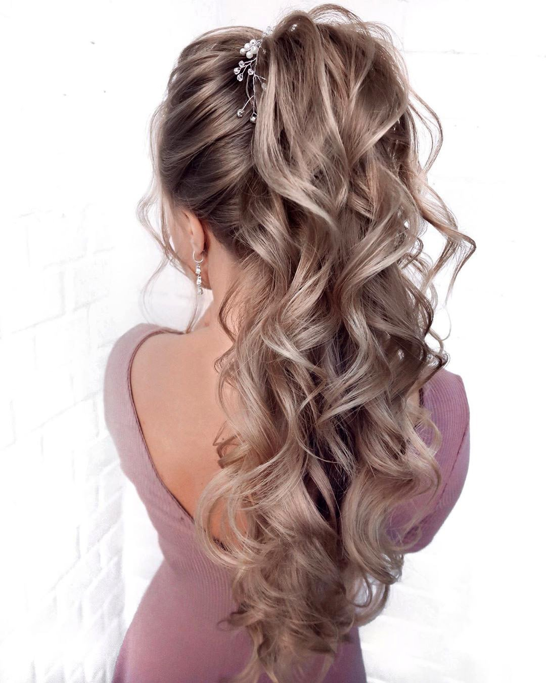 pony tail hairstyles extremely high curly on long hair mpobedinskaya