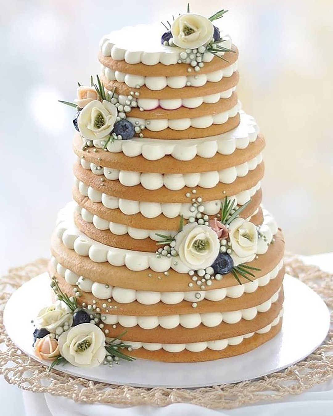 non traditional wedding dessert ideas tired cake with white cream flowers vkusnoisladko