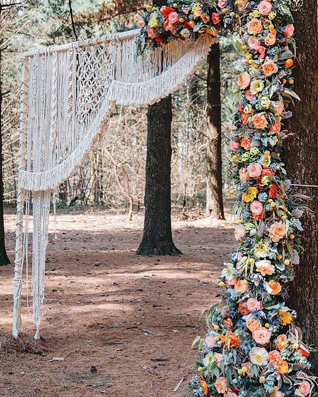 cheap boho decor arch with bright flowers and macrame mariabryzhko