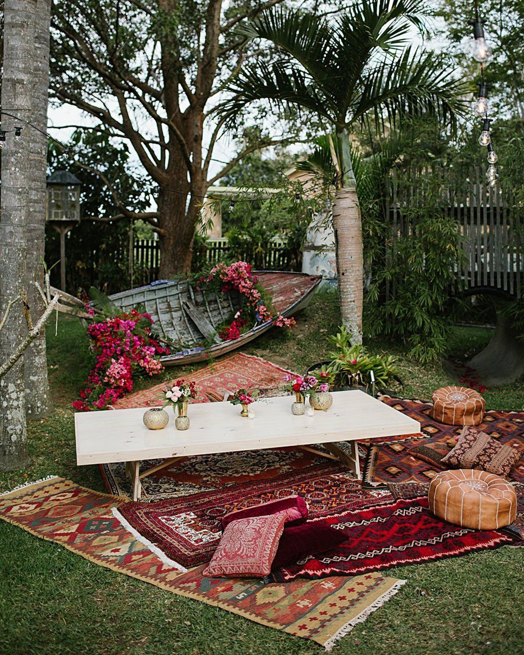 cheap boho decor backyard reception with red etnic carpets flowers boat heart and colour