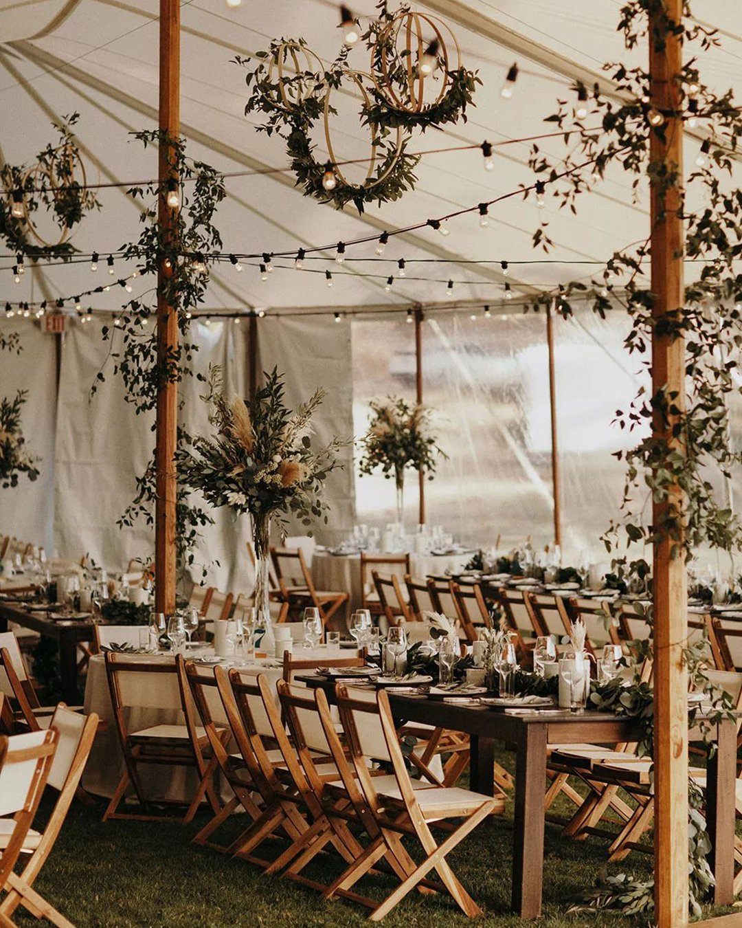 cheap boho decor reception under white tent Jordan Voth