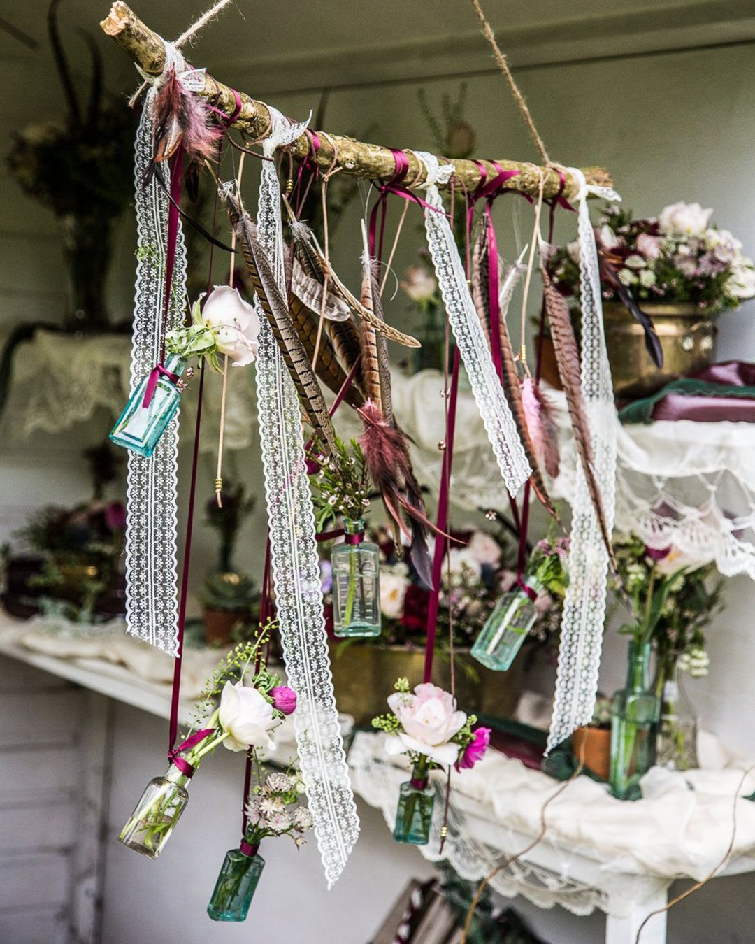 cheap boho decor suspended décor with flowers feathers and lace hayley pettit photography