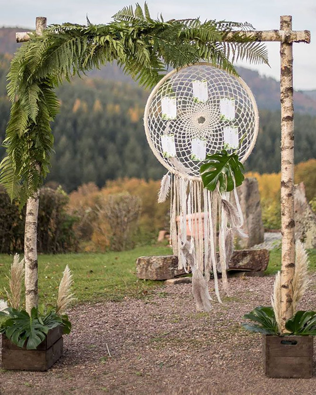 cheap boho decor wedding arch woodland with greenery and suspended dreamcatcher rosaliehartigfotografie via instagram