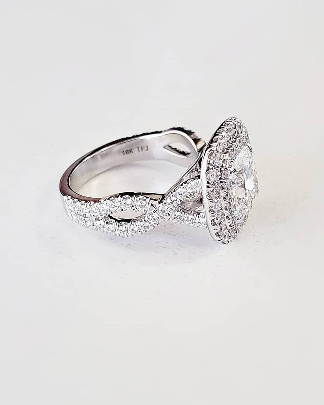 halo engagement rings twisted pave band