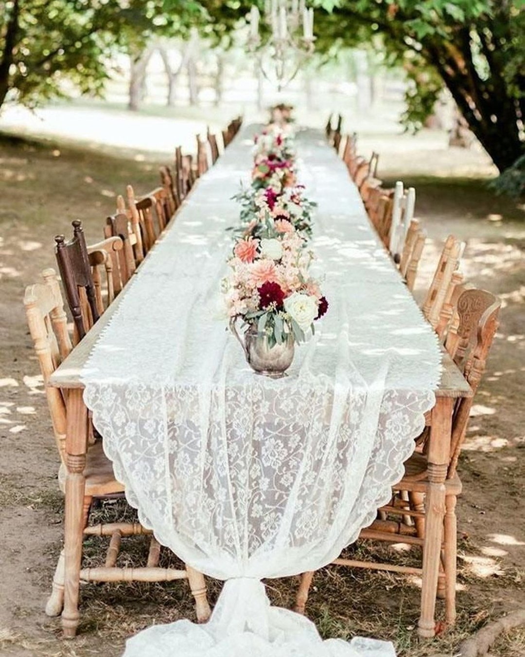 heap boho decor bohemian long table with vintage chairs and lace tablecloth oly photography