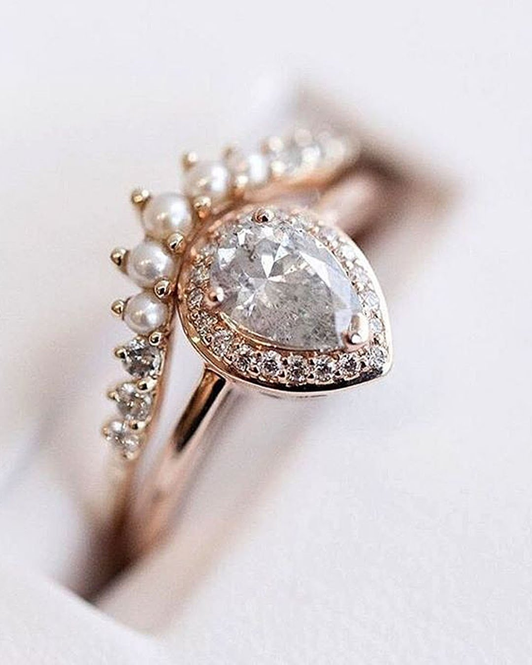 unique engagement rings rose gold pear cut gemstone halo sparkling